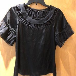Black silk blouse.
